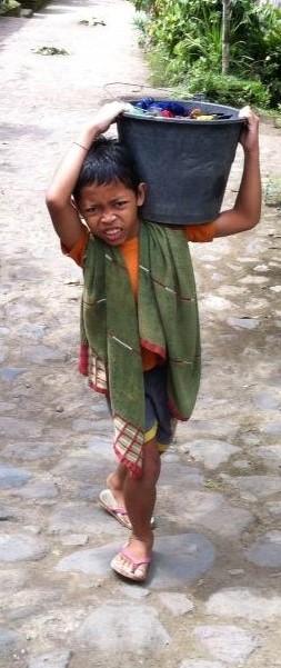 boy carrying bucket